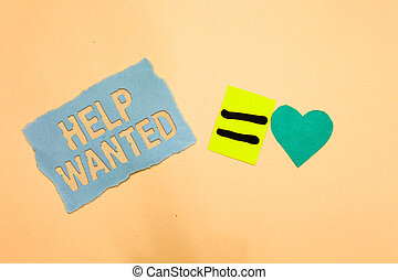 Writing note showing Help Wanted. Business photo showcasing advertisement placed in newspaper by employers seek employees Blue paper reminder turquoise heart sending romantic ideas.