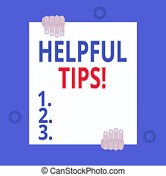 Writing note showing Helpful Tips. Business photo showcasing advices given to be helpful knowledge in life Two hands hold one big empty blank white paper placed on top and bottom.