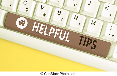 Writing note showing Helpful Tips. Business photo showcasing secret information or advice given to be helpful knowledge White pc keyboard with note paper above the white background.