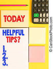 Writing note showing Helpful Tips Question. Business photo showcasing secret information or advice given to be helpful knowledge Colored empty papers with copy space on the yellow background table.