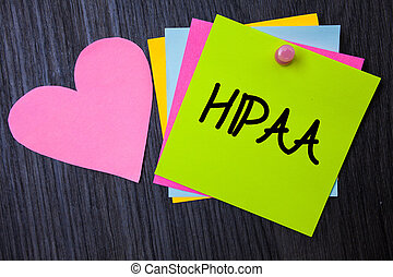 Writing note showing Hipaa. Business photo showcasing Health Insurance Portability and Accountability Act Healthcare Law Papers heart wood wooden background love lovely message ideas thoughts