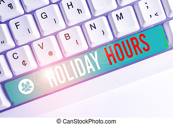 Writing note showing Holiday Hours. Business photo showcasing employee receives twice their normal pay for all hours White pc keyboard with note paper above the white background.