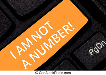 Writing note showing I Am Not A Number. Business photo showcasing Equality fighting for your rights individuality respect Keyboard key Intention to create computer message pressing keypad idea.