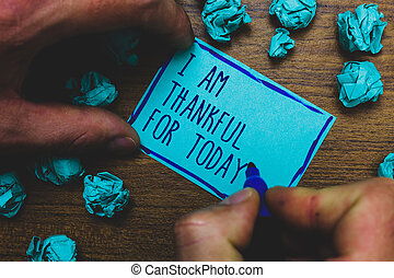 Writing note showing I Am Thankful For Today. Business photo showcasing Grateful about living one more day Philosophy Foggy hand hold marker drawn blue notepad paper lump on wooden floor.