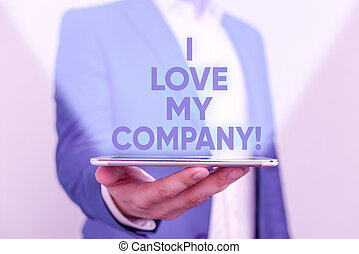 Writing note showing I Love My Company. Business photo showcasing tell why admire their job and workplace Man in the blue suite and white shirt holds mobile phone in the hand.