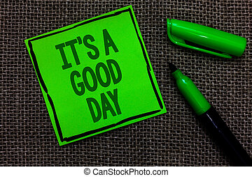 Writing note showing It s is A Good Day. Business photo showcasing Happy time great vibes perfect to enjoy life beautiful Black lined green sticky note with words open green pen on sack.