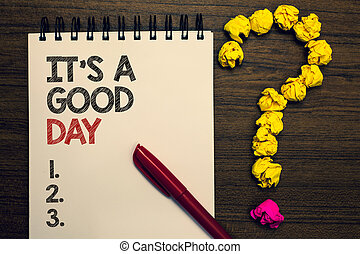 Writing note showing It s is A Good Day. Business photo showcasing Happy time great vibes perfect to enjoy life beautiful written on notepad red pen yellow paper lump question on wooden table.