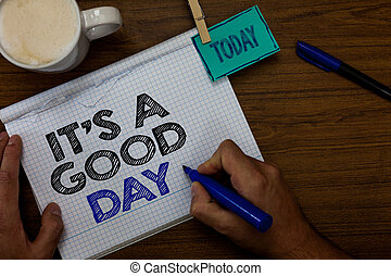 Writing note showing It s is A Good Day. Business photo showcasing Happy time great vibes perfect to enjoy life beautiful Hand hold pen coffee cup blue pen paper clip stick on woody table.