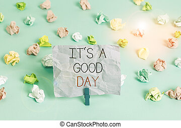 Writing note showing It s is A Good Day. Business photo showcasing Happy time great vibes perfect to enjoy life beautiful Colored crumpled papers empty reminder blue floor background clothespin.