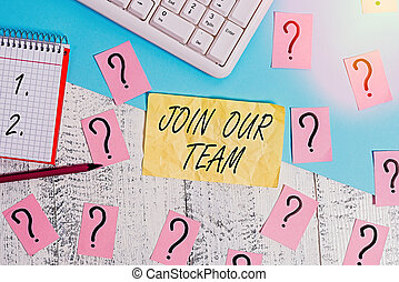 Writing note showing Join Our Team. Business photo showcasing inviting someone to join in your local group or company Writing tools and scribbled paper on top of the wooden table.