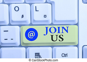 Writing note showing Join Us. Business photo showcasing Register in community Team or blog Sign up at social media White pc keyboard with note paper above the white background.