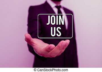 Writing note showing Join Us. Business photo showcasing Register in community Team or blog Sign up at social media Male human with beard wear formal working suit clothes hand.