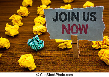 Writing note showing  Join Us Now. Business photo showcasing enroll community register website Recruit someone Sign-up Cardboard with letters wooden floor fuzzy yellow lumps green hunch.