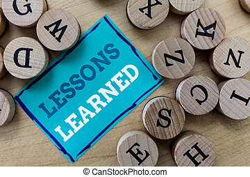 Writing note showing Lessons Learned. Business photo...
