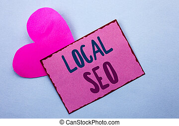 Writing note showing  Local Seo. Business photo showcasing Search Engine Optimization Strategy Optimize Local Find Keywords written on Pink Sticky Note Paper on the Plain background with Heart.