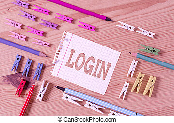 Writing note showing Login. Business concept for process by which an individual gains access to a computer system Colored clothespin papers empty reminder wooden floor background office