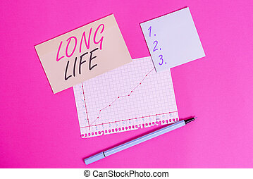 Writing note showing Long Life. Business photo showcasing able to continue working for longer than others of the same kind Stationary and note paper math sheet with diagram picture on the table.