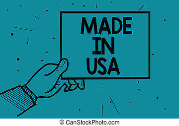 Writing note showing Made In Usa. Business photo showcasing American brand United States Manufactured Local product Man hand holding paper communicating dotted turquoise background.