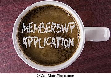 Writing note showing  Membership Application. Business photo showcasing Registration to Join a team group or organization written on Coffee in White Cup on the wooden background.