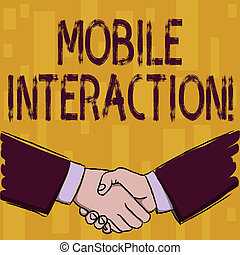 Writing note showing Mobile Interaction. Business photo showcasing the interaction between mobile users and computers Businessmen Shaking Hands Form of Greeting and Agreement.