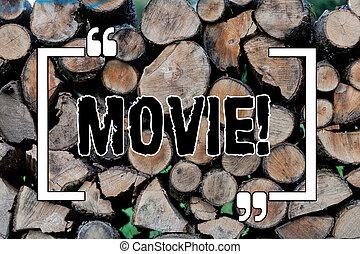 Writing note showing Movie. Business concept for Cinema or television film Motion picture Video displayed on screen Wooden background vintage wood wild message ideas intentions thoughts