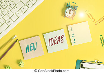 Writing note showing New Ideas. Business photo showcasing something original or fresh and more effective innovation Flat lay above copy space on the white crumpled paper.