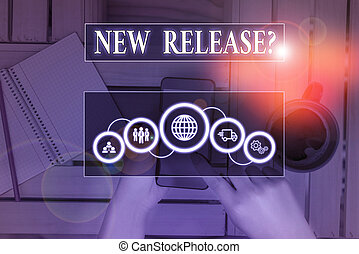 Writing note showing New Release Question. Business concept for asking about recent product or service newly unleashed Picture photo network scheme with modern smart device