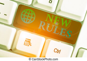 Writing note showing New Rules. Business concept for recently one of a set of explicit or understood regulations