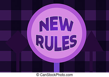Writing note showing New Rules. Business concept for recently one of a set of explicit or understood regulations Three Blank Safety Road signs One lighted and two dark Street Signage