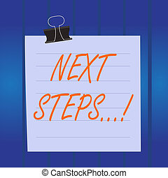 Writing note showing Next Steps. Business photo showcasing something you do after you have finished doing first one Paper lines binder clip suare notebook color background.