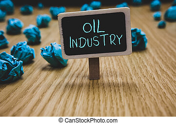 Writing note showing Oil Industry. Business photo showcasing Exploration Extraction Refining Marketing petroleum products Blackboard crumpled papers several tries not satisfied wooden floor.