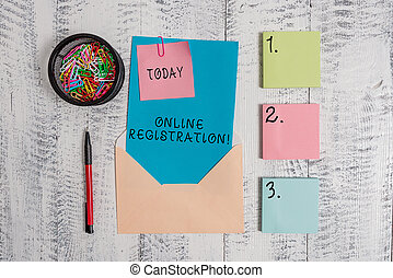 Writing note showing Online Registration. Business photo showcasing Process to Subscribe to Join an event club via Internet Envelope letter sticky note ballpoint clips on wooden background.