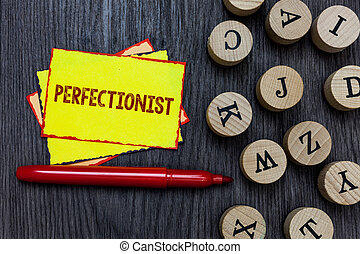 Writing note showing Perfectionist. Business photo showcasing Person who wants everything to be perfect Highest standards Multiple small sticky cards wood alphabet button pen grey background.