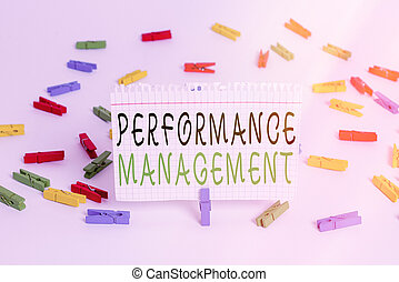 Writing note showing Performance Management. Business photo showcasing ongoing process of communication that occurs all year Colored clothespin papers empty reminder white floor background office.