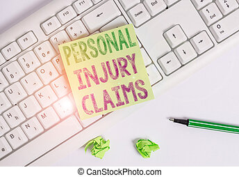 Writing note showing Personal Injury Claims. Business photo showcasing being hurt or injured inside work environment Green note paper with pencil on white background and pc keyboard.