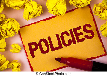 Writing note showing  Policies. Business photo showcasing Business Company or Government Rules Regulations Standards written on Sticky Note paper within Paper Balls on plain background.