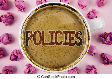 Writing note showing  Policies. Business photo showcasing Business Company or Government Rules Regulations Standards written on Coffee in White Cup within Paper Balls on plain background.