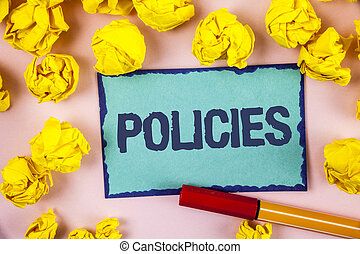 Writing note showing  Policies. Business photo showcasing Business Company or Government Rules Regulations Standards written on Sticky note paper within paper balls on plain background Pen