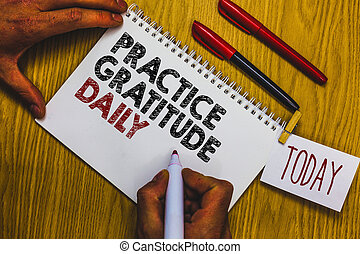 Writing note showing Practice Gratitude Daily. Business photo showcasing be grateful to those who helped encouarged you Man holding marker notebook clothepin reminder wooden table cup coffee.