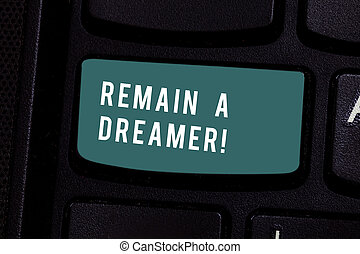 Writing note showing Remain A Dreamer. Business photo showcasing they spend lot of time thinking about and planning things Keyboard key Intention to create computer message pressing keypad idea.