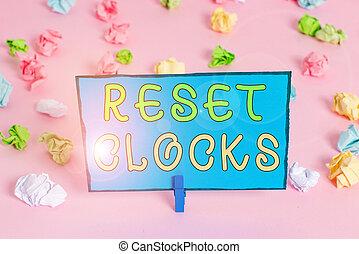 Writing note showing Reset Clocks. Business photo showcasing...