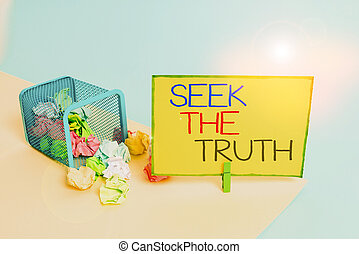 Writing note showing Seek The Truth. Business concept for Looking for the real facts Investigate study discover Trash bin crumpled paper clothespin reminder office supplies