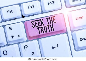 Writing note showing Seek The Truth. Business concept for Looking for the real facts Investigate study discover Keyboard with note paper on white background key copy space