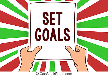 Writing note showing Set Goals. Business photo showcasing Defining or achieving something in the future based on plan Man holding paper important message remarkable red rays bright ideas.