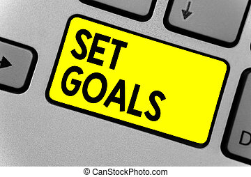 Writing note showing Set Goals. Business photo showcasing Defining or achieving something in the future based on plan Keyboard yellow key Intention computer computing reflection document.