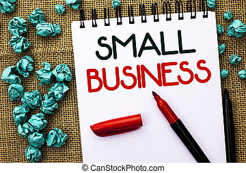 Writing note showing Small Business. Business photo showcasing Little Shop Starting Industry Entrepreneur Studio Store written on Notebook Book on the jute background Markers next to it.
