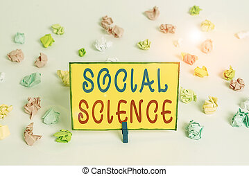 Writing note showing Social Science. Business concept for scientific study of huanalysis society and social relationships Colored crumpled paper empty reminder white floor clothespin