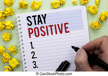 Writing note showing Stay Positive. Business photo showcasing Be Optimistic Motivated Good Attitude Inspired Hopeful written By Man Holding Marker Notebook Paper.