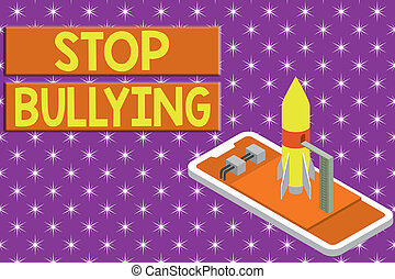 Writing note showing Stop Bullying. Business photo showcasing Fight and Eliminate this Aggressive Unacceptable Behavior Ready to launch rocket lying smartphone. Startup negotiations to begin.