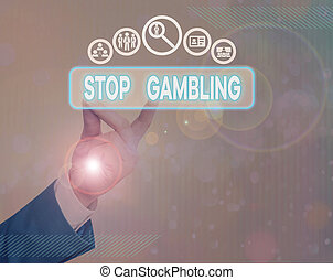Writing note showing Stop Gambling. Business photo showcasing stop the urge to gamble continuously despite harmful costs.